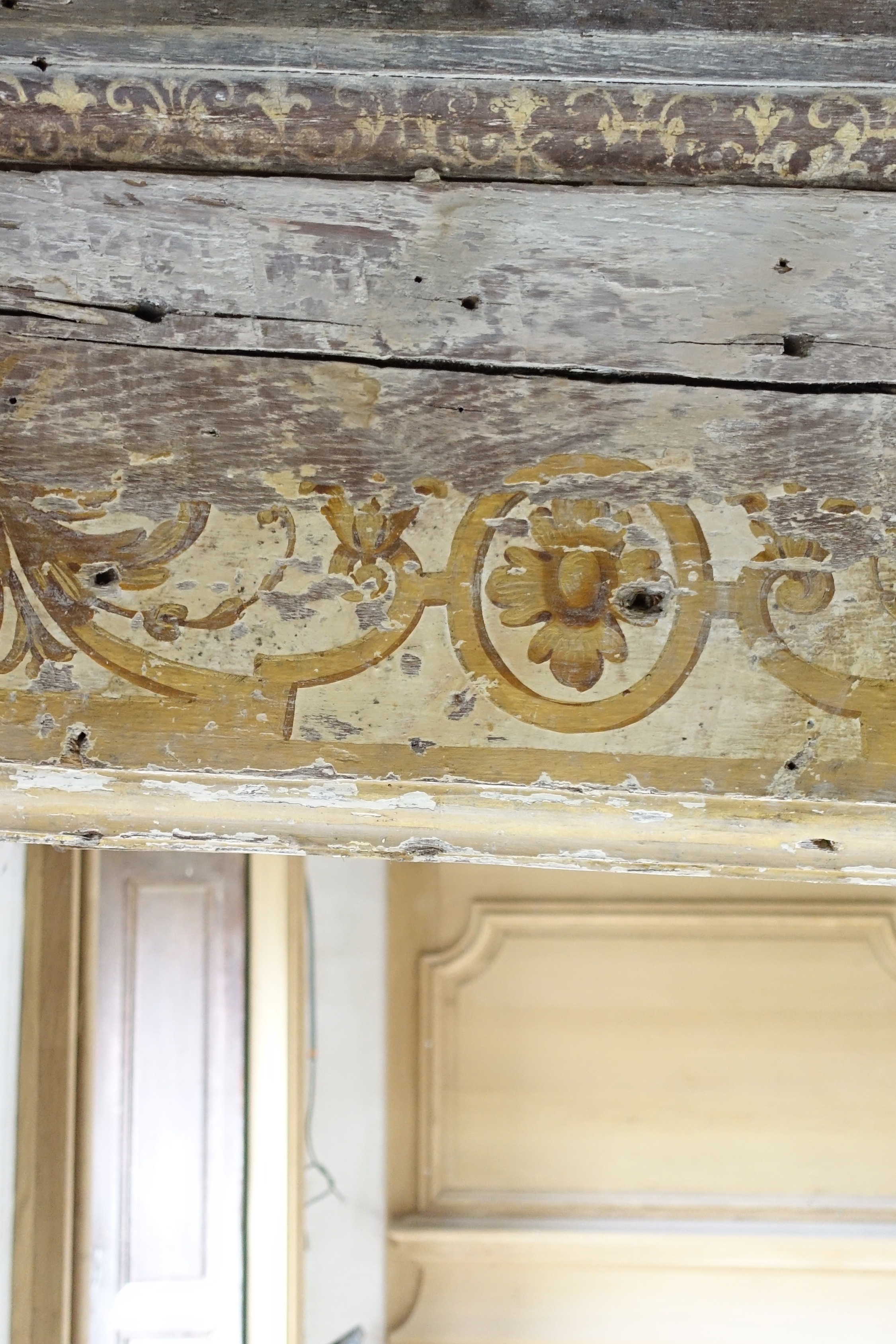 17e century painting decor on beams and ceiling